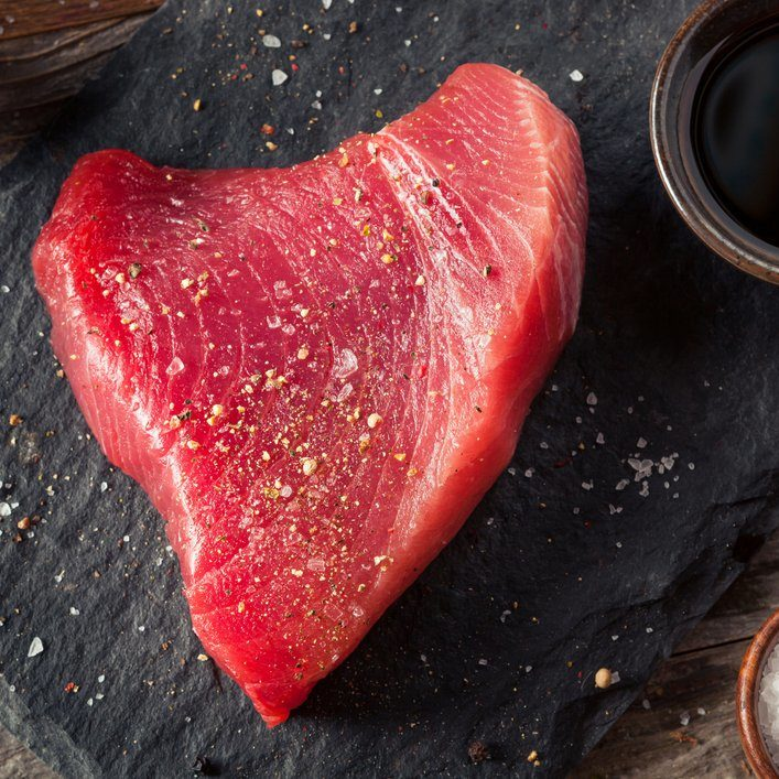 Raw Organic Pink Tuna Steak with Salt and Pepper